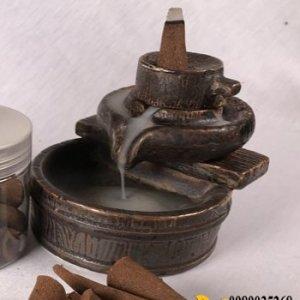 Thác khói xông trầm hương tượng cối xay